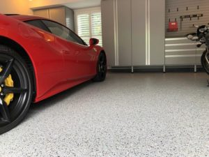 red car in garage with epoxy flooring